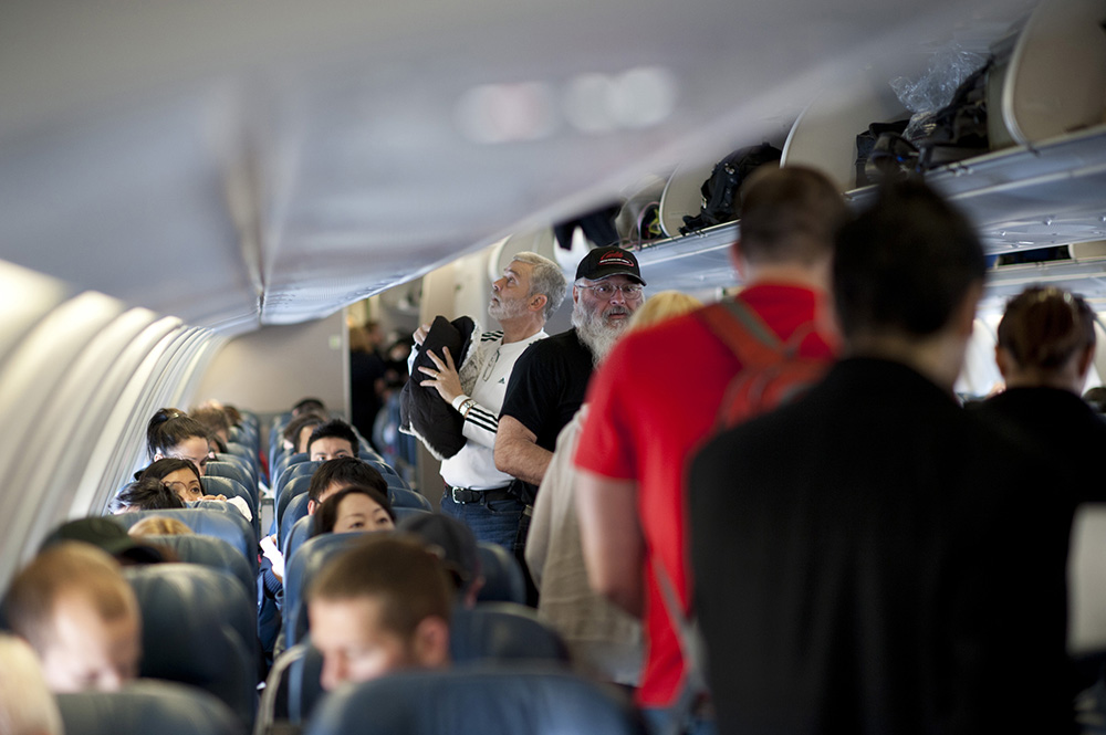 Supersized seatmates are a big problem for airlines and you