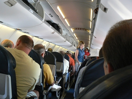 Is the art of social distancing on a plane possible?